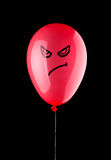 Angry red balloon Stock Image