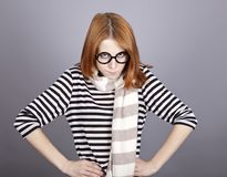 Angry red-haired girl in glasses and scarf. Stock Photography