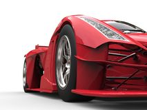 Angry red super race car - front view low angle shot vector illustration