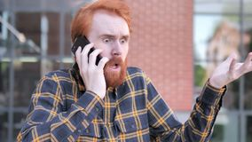 Angry Redhead Beard Young Man Talking on Phone stock video footage
