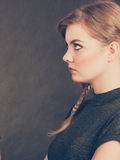 Angry resentful young blonde woman. Stock Images