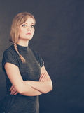 Angry resentful young blonde woman. Royalty Free Stock Photo