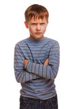 Angry restless evil kid gloomy blond boy in Royalty Free Stock Photo