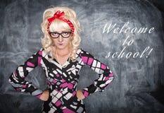 Angry retro teacher. On chalkboard blackboard background stock photos
