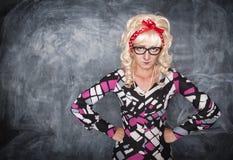 Angry retro teacher. On chalkboard blackboard background stock image