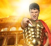 Angry roman legionary soldier. In front of coliseum Stock Image