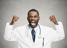 Angry rude upset male health care professional, doctor royalty free stock image