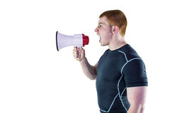 Angry rugby player yelling through the megaphone Royalty Free Stock Images