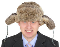 Angry Russian businessman in fur hat on white Stock Images