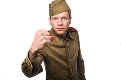 Angry russian soldier threaten with a fist. Second world war angry russian soldier threaten with a fist. Studio portrait isolated on white background Stock Photos
