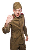 Angry russian soldier threaten with a fist. Second world war angry russian soldier threaten with a fist. Studio portrait isolated on white background Royalty Free Stock Photos
