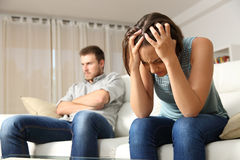 Angry and sad couple after argument. Angry boyfriend and sad girlfriend at home. Couple worried after argument stock images