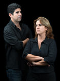Angry and sad couple isolated on black Stock Photo