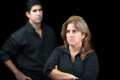 Angry and sad couple isolated on black Royalty Free Stock Photo