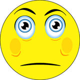 Angry and sad face. Big yellow emoticon showing sad and angry feelings Royalty Free Stock Photography