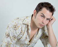 Angry And Sad Young Man. Young man expression both anger and sadness, perhaps at the pressures of modern life Stock Photo