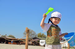 Angry sailor boy with toys on sunny beach Stock Photography