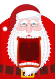 Angry Santa Claus shouts. Scary grandfather yelling. Crazy Santa Royalty Free Stock Photo