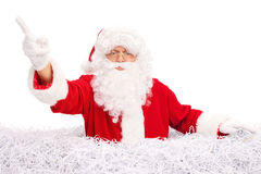 Angry Santa standing in a pile of shredded paper Royalty Free Stock Photography