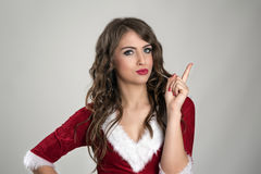 Angry Santa woman scolding finger and looking at camera Royalty Free Stock Images