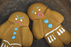 Angry and scared gingerbread men Royalty Free Stock Photos