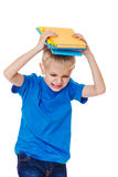 Angry school boy. Portrait of an angry school boy with books Stock Photography