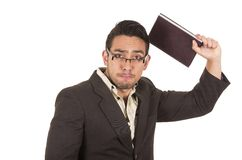 Angry school teacher throwing book Royalty Free Stock Photos
