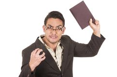 Angry school teacher throwing book Stock Photos