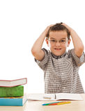 Angry schoolboy. Tearing his hair - isolated Royalty Free Stock Images