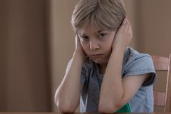 Angry schoolboy covering his ears Stock Images