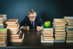 Angry schoolboy in stress or depression at school classroom Royalty Free Stock Image
