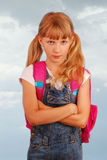 Angry schoolgirl against cloudly sky Stock Images