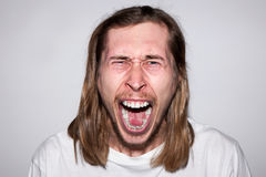Angry screaming man. Rage emotion Royalty Free Stock Image