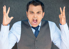 Angry screaming boss, hands in air. Closeup portrait of bitter displeased pissed off, angry grumpy man in tie, open mouth, hands in air, screaming and yelling Royalty Free Stock Photo