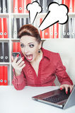 Angry screaming business woman with telephone. In office Royalty Free Stock Image