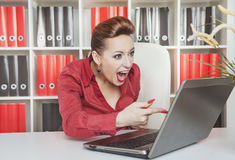 Angry screaming business woman working with computer Stock Image