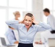 Angry screaming businesswoman Stock Photos