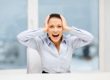 Angry screaming businesswoman in office Royalty Free Stock Photos