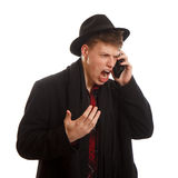 Angry screaming on the phone. An young adult screaming on the phone Royalty Free Stock Image