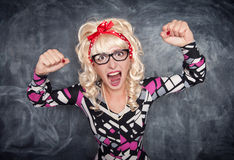 Angry screaming retro teacher. On chalkboard blackboard background royalty free stock image