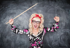 Angry screaming retro teacher with pointer. On chalkboard blackboard background royalty free stock images