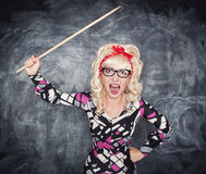 Angry screaming retro teacher with pointer. On chalkboard blackboard background royalty free stock photo