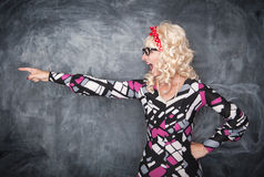 Angry screaming retro teacher pointing out. On chalkboard blackboard background stock photos