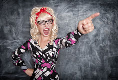Angry screaming retro teacher pointing out stock images