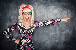 Angry screaming retro teacher pointing out. On chalkboard blackboard background royalty free stock photo