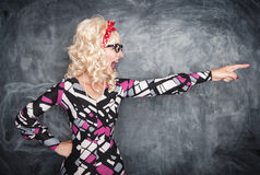 Angry screaming retro teacher pointing out. On chalkboard blackboard background royalty free stock image