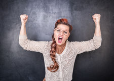 Angry screaming teacher. On chalkboard blackboard background stock photo
