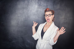 Angry screaming teacher. On chalkboard blackboard background royalty free stock images