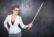Angry screaming teacher with pointer on blackboard background. Angry screaming teacher with pointer on the chalkboard blackboard background stock photos