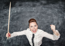 Angry screaming teacher with pointer Royalty Free Stock Image
